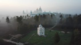 New Jerusalem monastery in Istra. New Jerusalem Orthodox monastery located in Istra. Morning mist landscape. Aerial view stock video