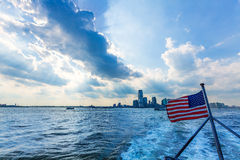 New Jerysey city skyline with American flag Royalty Free Stock Photo