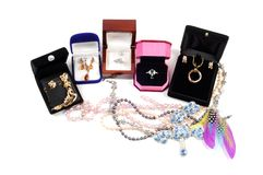New jewelry in open boxes Stock Photo