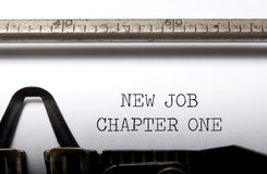 New job. Chapter one typed on a vintage typewriter Royalty Free Stock Image
