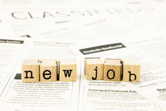 New job wording stack on classifieds ads. Closeup new job wording on classifieds ads and newspaper, recruitment and employment concepts and ideas stock photos