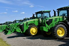 New John Deer tractors 6195 R and 8320 R. HAWLEY, MINNESOTA, August 22, 2017: The 6195 R and 8320 R tractors are products of John Deere Co, an American Royalty Free Stock Image
