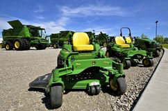 New John Deere combines and riding lawn mowers Royalty Free Stock Photo