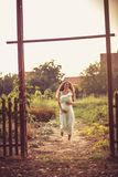 New journey through life. Pregnant woman walking on road. Copy space stock photo