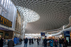 New King's Cross Station. London, UK -- Mar 14, 2015: A view of New King's Cross Station Architecture with people walking in morning royalty free stock photo
