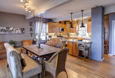New kitchen and diningroom remodel. New home remodel with new kitchen and diningroom in eclectic style. Artwork in background is the authors Royalty Free Stock Image