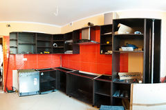 New kitchen furniture. Panorama of a new kitchen interior with new furniture being installed Stock Images