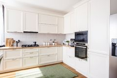 New kitchen interior with modern furniture in luxurious home Royalty Free Stock Photos