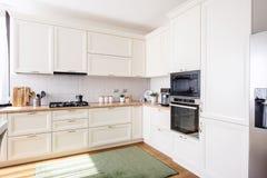 New kitchen interior with modern furniture in luxurious home. New kitchen interior with wood furniture in luxurious home royalty free stock photos