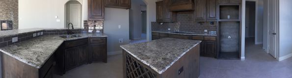 New kitchen with island counter under construction. Interior of a new kitchen with island counter under construction, TX USA. It is panoramas picture Royalty Free Stock Images