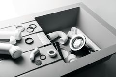 New kitchen sink with plumbing fittings. On white Stock Photo
