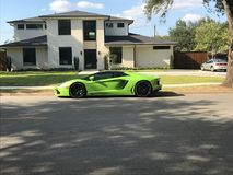 A new Lamborghini Aventador parked outside a home royalty free stock photography