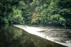 New Lanark in Scotland with forest and river Clyde. United Kingdom Royalty Free Stock Photos
