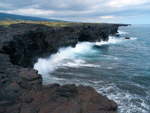 New land created by lava flows pounded by the Pacific Ocean waves. Big Island Volcano National Park Hawaii stock image