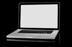 New laptop with white screen on a black background. Modern silver laptop with white screen, black frame screen and black keyboard. Isolated on a black background Stock Image