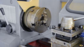 A new lathe that was not in use. Lathe chuck and tool holder in the factory protective grease. stock footage