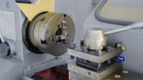 A new lathe that was not in use. Lathe chuck and tool holder in the factory protective grease. stock video