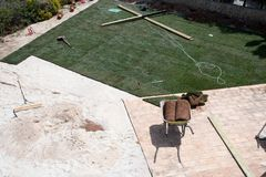 New lawn being created. With rolls of turf stock photo