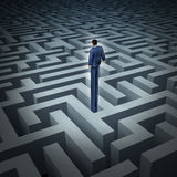 New Leadership Vision. For finding solutions with a businessman who has grown long legs to see above through a complicated maze or labyrinth as a business Stock Images