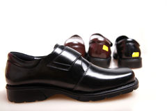 New leather shoes. On white background Royalty Free Stock Images