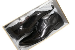 New leather shoes in box. A pair of new black leather shoes inside a box isolated on white Stock Photography
