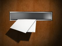 New letters in the letter box. New mail letters sticking out of a letter box Royalty Free Stock Photo