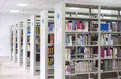 New library. With lots of shelves and books Royalty Free Stock Image
