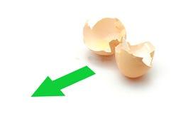 New life. Empty eggshell and a green arrow, symbolize new life Royalty Free Stock Photo