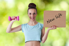 New life. Concept of healthy lifestyle, girl doing sport royalty free stock image
