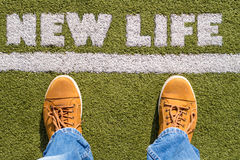 New Life concept. Man's legs behind the white line from above with New Life sign Royalty Free Stock Photos