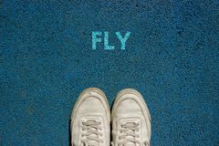 New Life Concept, Motivational Slogan with Word FLY on the Ground of Walk Way stock photos
