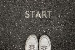New Life Concept, Motivational Slogan with Word START on the ground of asphalt stock photo