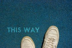 New Life Concept, Motivational Slogan with Word THIS WAY on the Ground of Walk Way stock photo