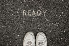 New Life Concept, Motivational Slogan with Word READY on the ground of asphalt stock images