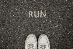 New Life Concept, Motivational Slogan with Word RUN on the ground of asphalt stock image