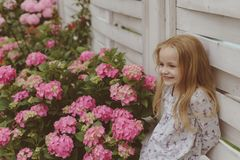 New life concept. Spring holiday. Childrens day. Small baby girl. Little girl at blooming flower. Summer. Mothers or. Womens day. Spring flowers. Childhood royalty free stock image