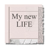 New life concept. New life words on piece of newspaper with torned eadges stock image