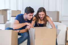 New life. Couple in love moving and keep a box in his hands and Royalty Free Stock Image