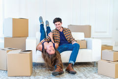 New life. Couple in love moving and keep a box in his hands and Royalty Free Stock Images