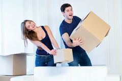 New life. Couple in love moving and keep a box in his hands and Royalty Free Stock Photography