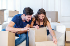 New life. Couple in love moving and keep a box in his hands and Royalty Free Stock Photo