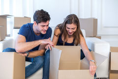 New life. Couple in love moving and keep a box in his hands and royalty free stock photos