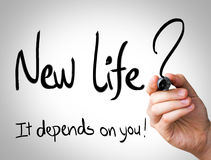 New Life, it depends on you Hand writing with black marker on transparent wipe board.  Stock Images