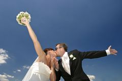 New life directions. Happy, just married couple. Kiss Stock Photography