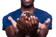 New life in his hands. Stock Photo