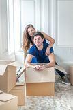 New life in a new home. Couple in love enjoys a new apartment an stock photos