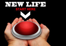 New Life Red Button. Hands Offering A Large Button For Starting A New Life Stock Photo