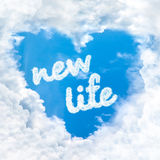 New life word inside love cloud blue sky only. New life word inside love cloud heart shape blue sky background only royalty free stock image