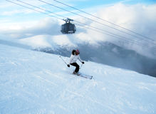 New lift, fog and girl on the ski. Stock Images