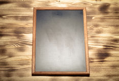 New light wooden burned texture with chalk board for background. Stock Photography